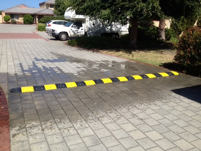 yellow and black Speed humps in car parks